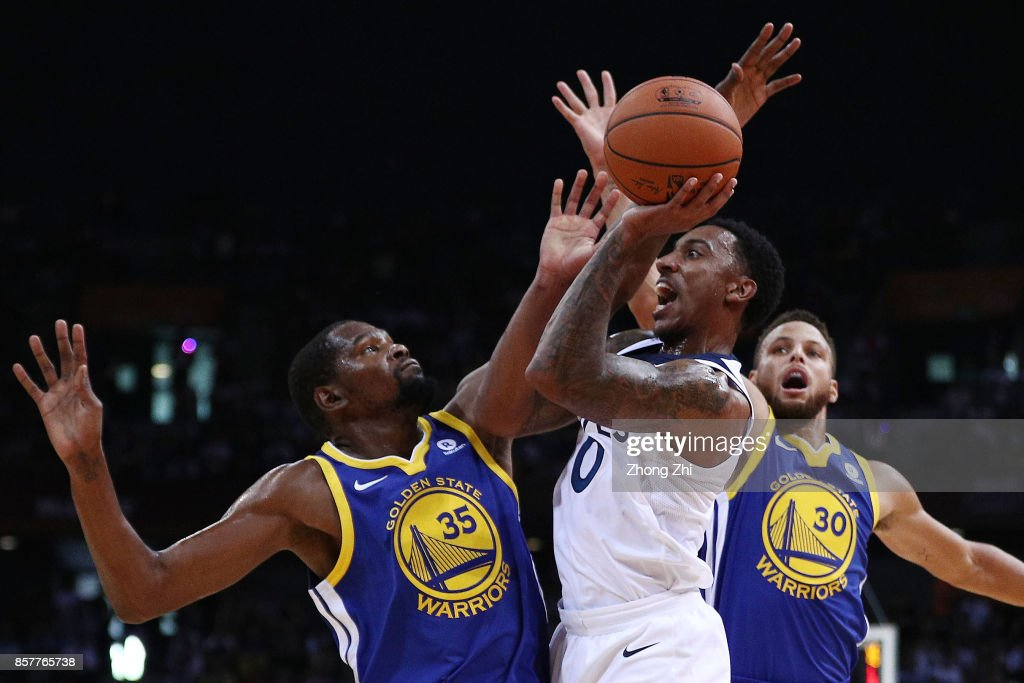 Jeff Teague #0 of the Minnesota Timberwolves in action while Stephen Curry #30 and Kevin Durant #35 of the Golden State Warriors during the game between the Minnesota Timberwolves and the Golden State Warriors as part of 2017 NBA Global Games China at Universidade Center on October 5, 2017 in Shenzhen, China.
