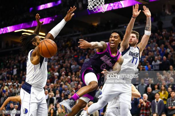 Jeff Teague of the Minnesota Timberwolves passes the ball against the Dallas Mavericks in the fourth quarter at Target Center on January 11 2019 in...