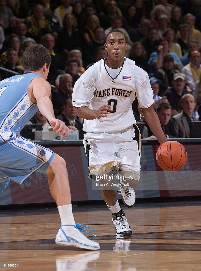 Jeff Teague #0 of the Wake Forest Demon Deacons brings the ball up court as Bobby Frasor #4 of the North Carolina Tar Heels defends at the LJVM Coliseum January 11, 2009 in Winston-Salem, North Carolina. The Demon Deacons defeated the Tar Heels 92-89.