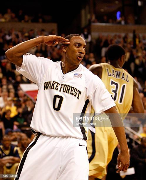 Jeff Teague of the Wake Forest Demon Deacons salutes fans after scoring a basket against the Georgia Tech Yellow Jackets during their game at...