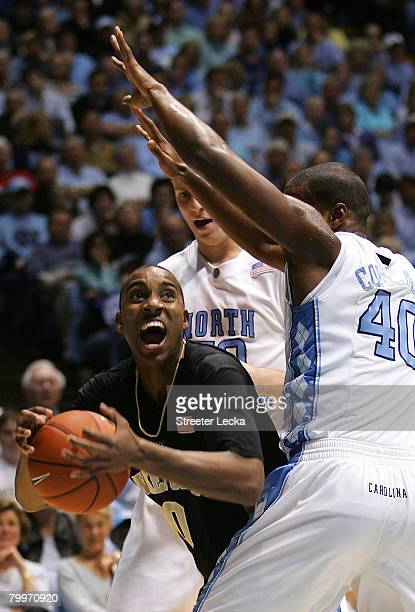 Jeff Teague of the Wake Forest Demon Deacons tries to keep the ball away from Tyler Hansbrough and Mike Copeland of the North Carolina Tar Heels...