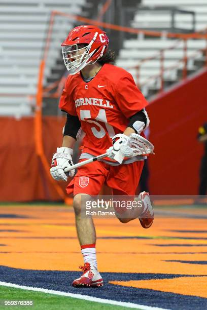 Jeff Teat of the Cornell Big Red controls the ball against the Syracuse Orange during a 2018 NCAA Division I Men's Lacrosse Championship First Round...