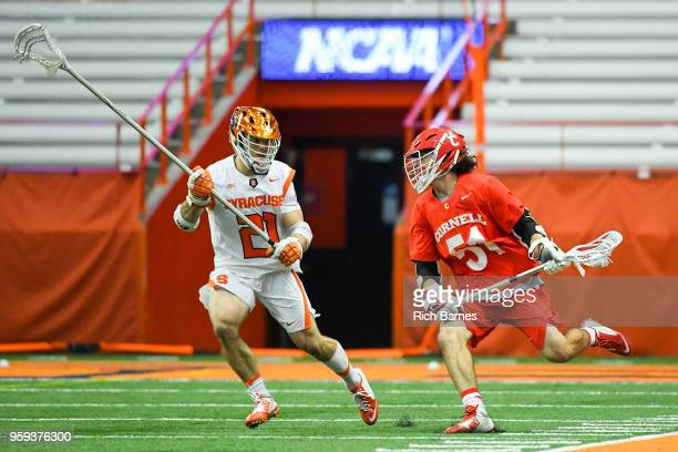 Jeff Teat of the Cornell Big Red controls the ball as Nick Mellen of the Syracuse Orange defends during a 2018 NCAA Division I Men's Lacrosse...