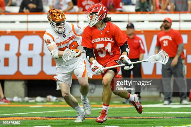 Jeff Teat of the Cornell Big Red dodges to the goal as Andrew Helmer of the Syracuse Orange defends during a 2018 NCAA Division I Men's Lacrosse...