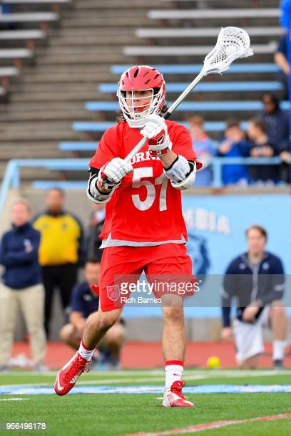 Jeff Teat of the Cornell Big Red passes the ball against the Yale Bulldogs during the 2018 Ivy League Men's Lacrosse Championship at Lawrence A Wien...