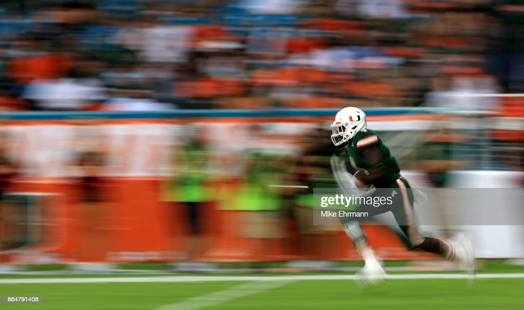 Jeff Thomas #4 of the Miami Hurricanes returns a kick during a game against the Syracuse Orange at Sun Life Stadium on October 21, 2017 in Miami Gardens, Florida.