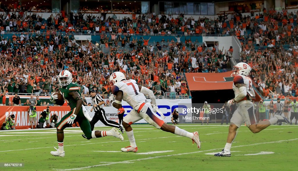 Jeff Thomas #4 of the Miami Hurricanes scores a touchdown during a game against the Syracuse Orange at Sun Life Stadium on October 21, 2017 in Miami Gardens, Florida.