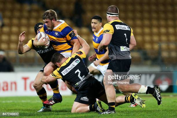 Jeff Thwaites of Bay of Plenty is tackled by Ricky Riccitelli of Taranaki during the round five Mitre 10 Cup match between Taranaki and Bay of Plenty...