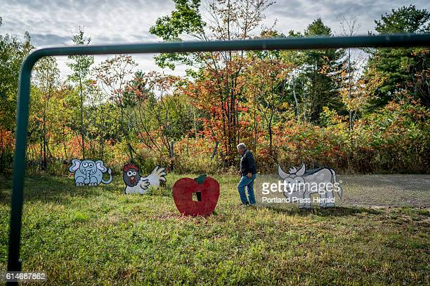 Jeff Timberlake a state lawmaker representing Turner walks amongst the apple shooting targets he has set up at his business Ricker Hill Orchards...