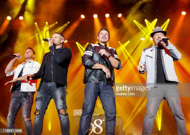 Jeff Timmons Drew Lachey Nick Lachey and Justin Jeffre of 98 Degrees perform on stage during Summer Night Concerts at PNE Amphitheatre on August 20...