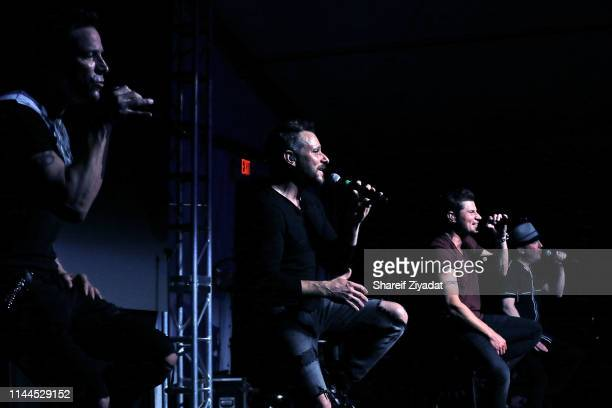 Jeff Timmons Drew Lachey Nick Lachey and Justin Jeffre of the group 98 Degrees perform during Under The Stars 2019 at Riverside Yacht Club on May 17...
