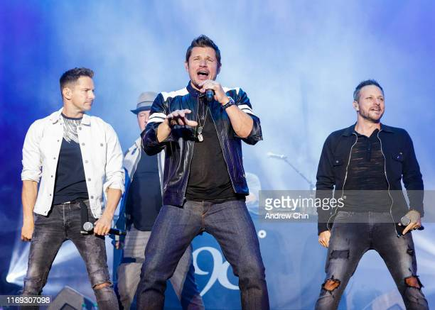 Jeff Timmons Justin Jeffre Nick Lachey and Drew Lachey of 98 Degrees perform on stage during Summer Night Concerts at PNE Amphitheatre on August 20...