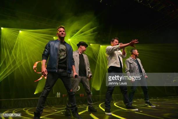 Jeff Timmons, Justin Jeffre, Nick Lachey and Drew Lachey of 98 Degrees perform on stage at Seminole Casino Coconut Creek on February 28, 2020 in...