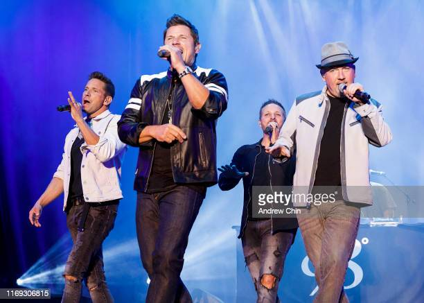 Jeff Timmons Nick Lachey Drew Lachey and Justin Jeffre of 98 Degrees perform on stage during Summer Night Concerts at PNE Amphitheatre on August 20...