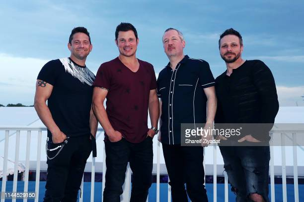 Jeff Timmons Nick Lachey Justin Jeffre and Drew Lachey of the group 98 Degrees attend Under The Stars 2019 at Riverside Yacht Club on May 17 2019 in...