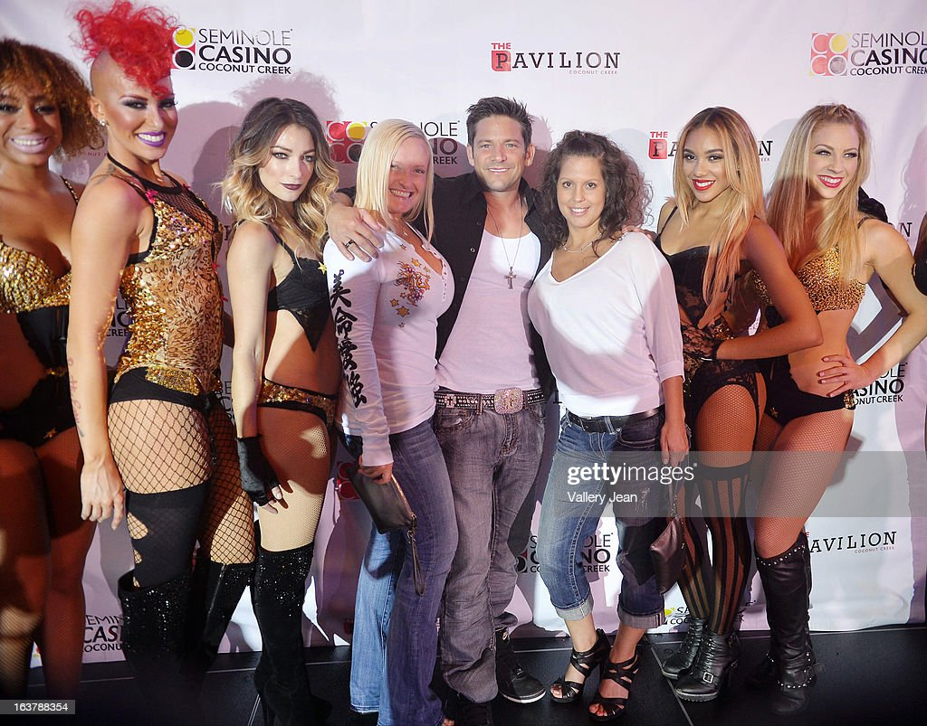 Jeff Timmons (C) poses for a portrait after The Knockouts Burlesque Show at Seminole Casino Coconut Creek on March 15, 2013 in Coconut Creek, Florida.