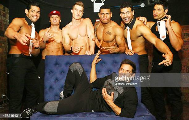 Jeff Timmons poses for photos with Joel Sajiun, Chris Boudreaux, Kyle Efthemes, Nate Estimada and Garo Bechirian of Men Of The Strip at The Gramercy...