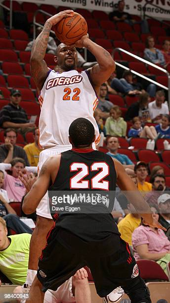 Jeff Trepagnier of the Iowa Energy spots up for a jumper over Brian Hamilton of the Utah Flash in the second half of game three of their opening...