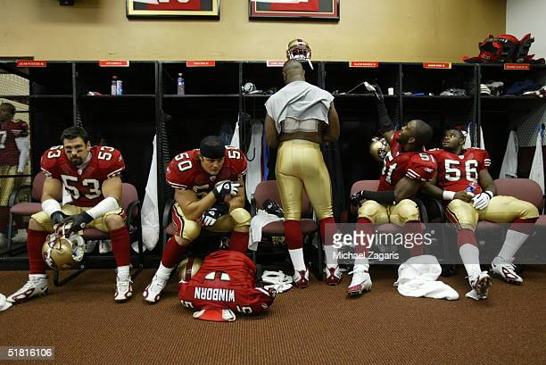 Jeff Ulbrich Derek Smith Jamie Winborn Shawntae Spencer and Brandon Moore of the San Francisco 49ers in the locker room before the game against the...