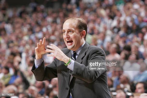 Jeff Van Gundy coach of the Houston Rockets frantically calls out a play against the Dallas Mavericks in Game seven of the Western Conference...