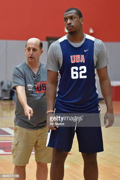 Jeff Van Gundy head coach of the USA AmeriCup Team coaches Jonathan Holmes during a training camp at the University of Houston in Houston Texas on...