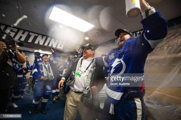Jeff Vinik and Nikita Kucherov of the Tampa Bay Lightning celebrates in the locker room with the Stanley Cup after the Tampa Bay Lightning defeated...