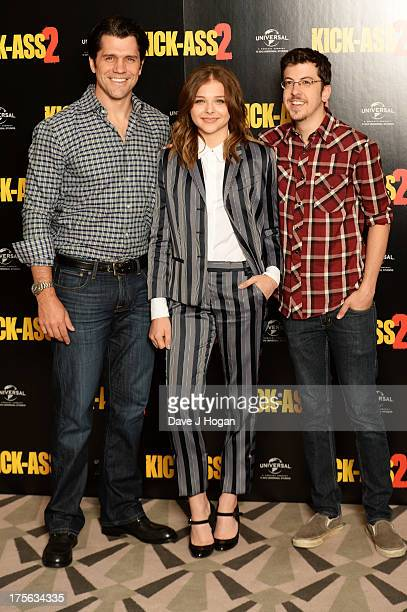 Jeff Wadlow Chloë Grace Moretz and Christopher MintzPlasse attend a photocall for KickAss 2 at Claridges Hotel on August 5 2013 in London England