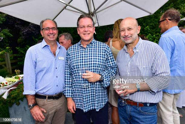 Jeff Wallerstein Stephen Scherr and Lloyd Blankfein attend the 2018 NYSCF Summer Cocktail Reception at a Private Residence on July 27 2018 in...