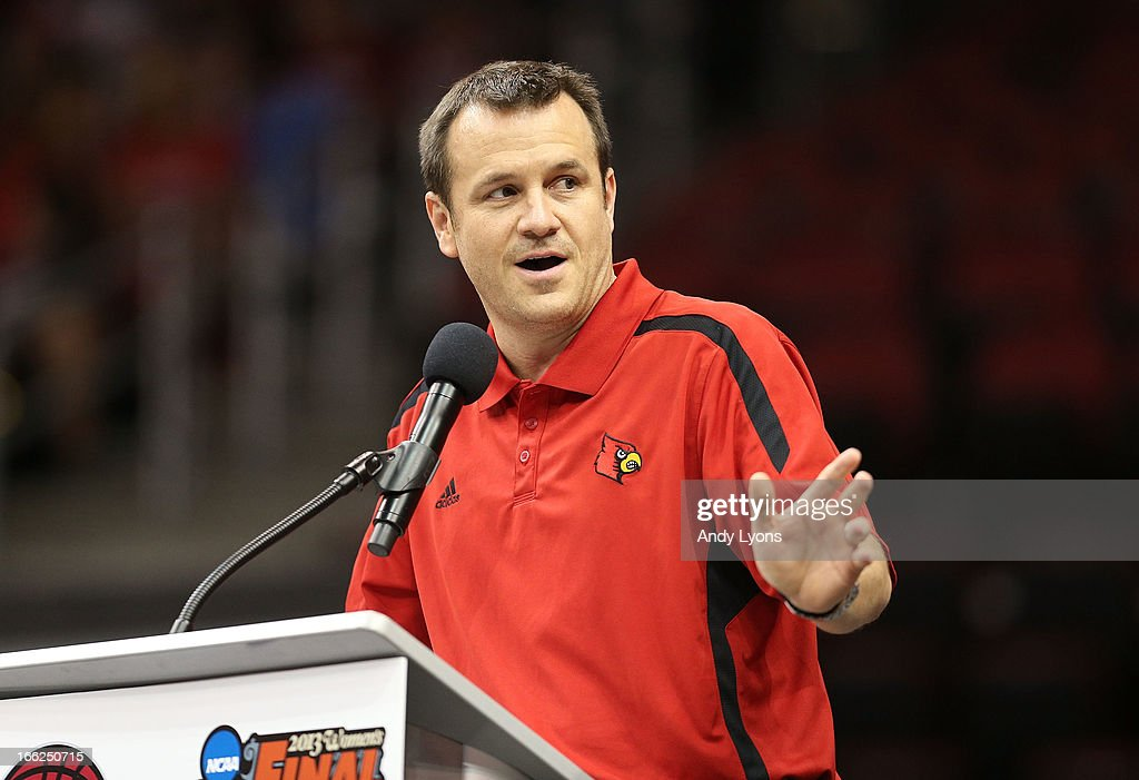 Jeff Waltz the head coach of the Louisville Cardinals Womens team talks during the Louisville Cardinals NCAA Basketball Celebration to mark the NCAA championship by the Mens team and the runner-up finish by the womens team at KFC YUM! Center on April 10, 2013 in Louisville, Kentucky.