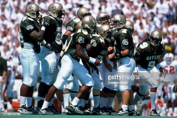 Jeff Watson, Quarterback for the Baylor University Bears talks to his offensive line in the huddle during a NCAA Big East Conference college football...
