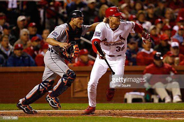Jeff Weaver of the St. Louis Cardinals runs to first on a fielders' chcoice to pitcher Justin Verlander of the Detroit Tigers in the bottom of the...