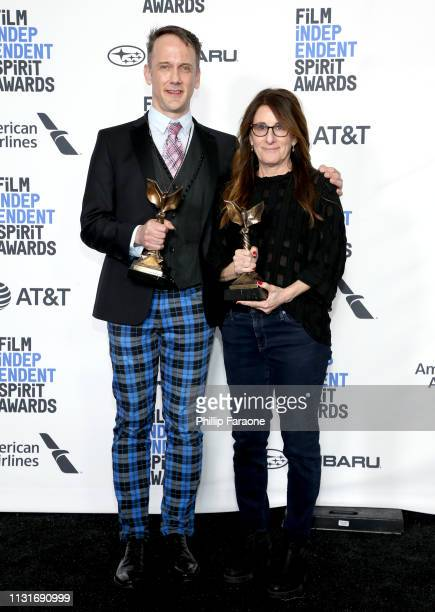 "Jeff Whitty and Nicole Holofcener pose in the press room with the Best Screenplay award for the film ""Can You Ever Forgive Me"" during the 2019 Film..."