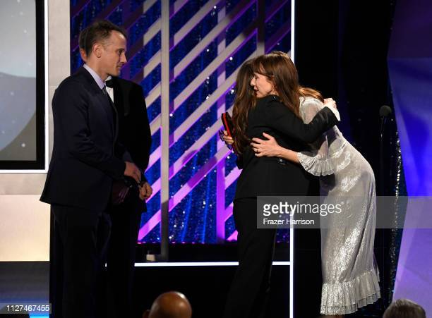 Jeff Whitty Nicole Holofcener and Dolly Wells onstage at the 18th Annual AARP The Magazine's Movies For Grownups Awards at the Beverly Wilshire Four...