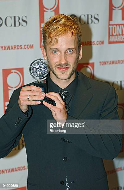 Jeff Whitty poses with his Tony award for Best Book of a Musical for the play Avenue Q at Radio City Music Hall in New York Sunday June 6 2004