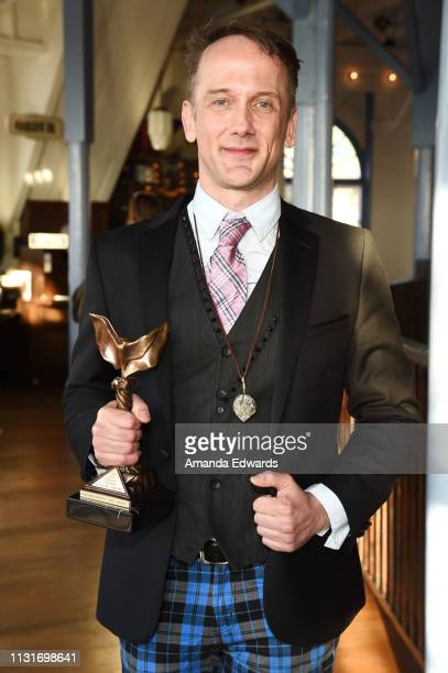 Jeff Whitty poses with the award for Best Screenplay during the 2019 Film Independent Spirit Awards after party on February 23 2019 in Santa Monica...