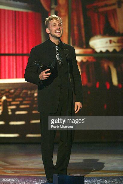 Jeff Whitty winner of Best Book Of A Play for Avenue Q appears on stage during the 58th Annual Tony Awards at Radio City Music Hall on June 6 2004 in...