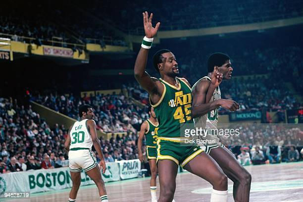Jeff Wilkins of the Utah Jazz posts up against Robert Parish of the Boston Celtics during a game played in 1982 at the Boston Garden in Boston...
