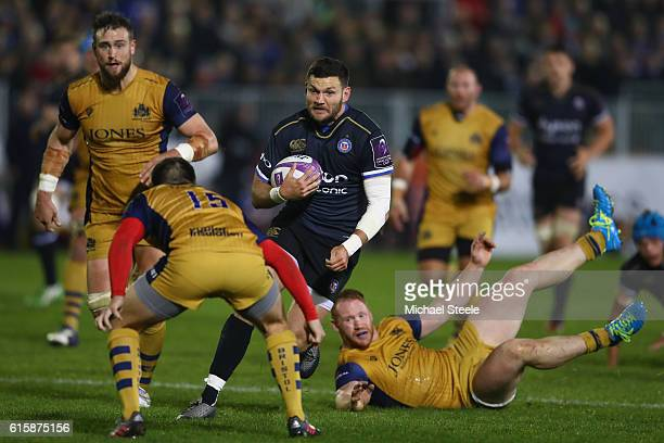 Jeff Williams of Bath runs at Jordan Williams of Bristol as Will Hurrell looks on during the European Rugby Challenge Cup Pool Four match between...