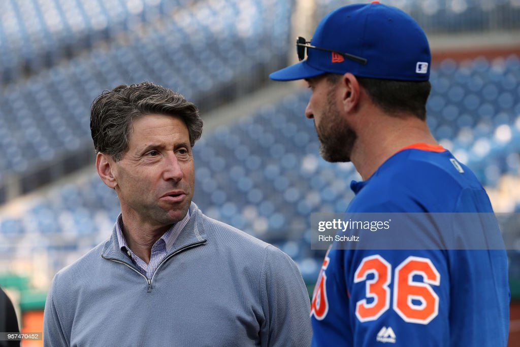 Jeff Wilpon COO of the New York Mets talks with manager Mickey Callaway #36 before a game against the Philadelphia Phillies at Citizens Bank Park on May 11, 2018 in Philadelphia, Pennsylvania.