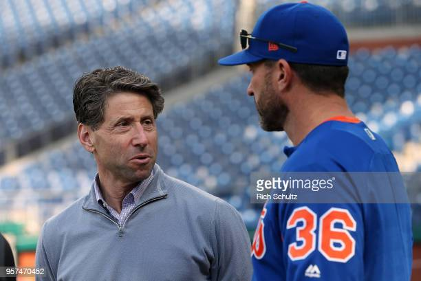 Jeff Wilpon COO of the New York Mets talks with manager Mickey Callaway before a game against the Philadelphia Phillies at Citizens Bank Park on May...