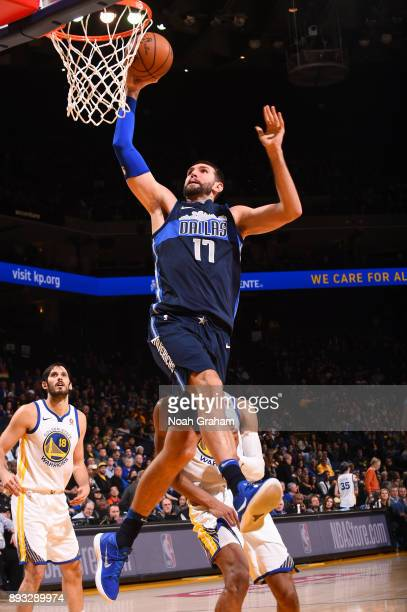 Jeff Withey of the Dallas Mavericks goes to the basket against the Golden State Warriors on December 14 2017 at ORACLE Arena in Oakland California...