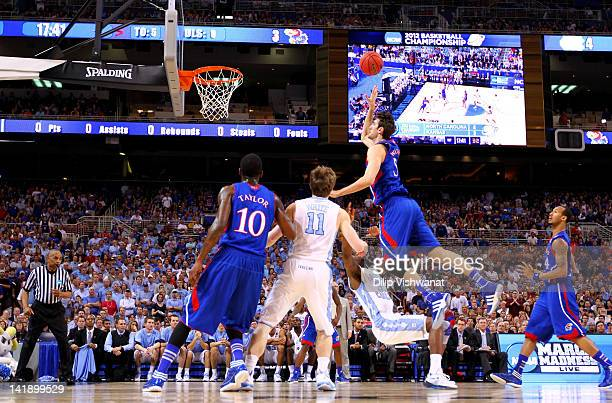 Jeff Withey of the Kansas Jayhawks drives for a shot attempt in the first half against Reggie Bullock of the North Carolina Tar Heels during the 2012...