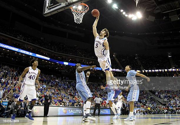 Jeff Withey of the Kansas Jayhawks dunks in the first half against the North Carolina Tar Heels during the third round of the 2013 NCAA Men's...