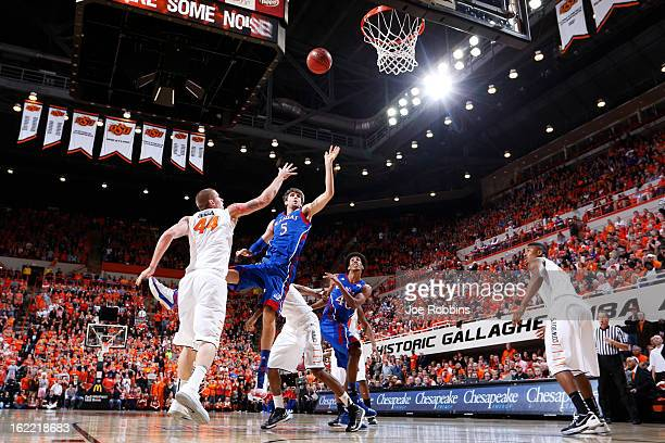 Jeff Withey of the Kansas Jayhawks shoots the ball against Philip Jurick of the Oklahoma State Cowboys during the game at Gallagher-Iba Arena on...