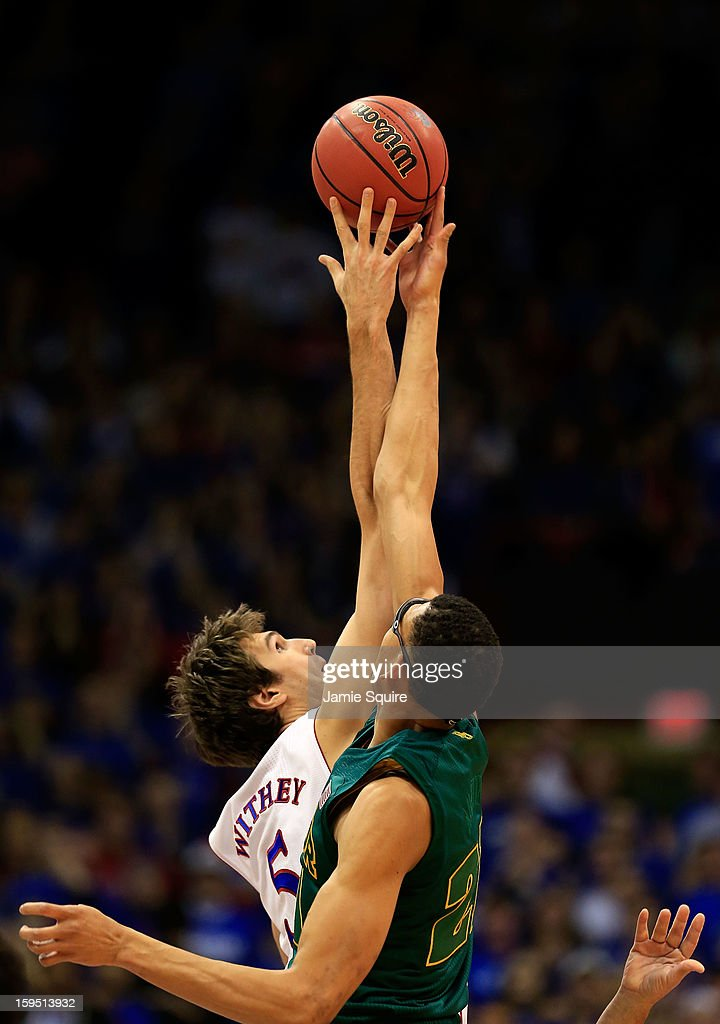 Jeff Withey #5 of the Kansas Jayhawks tips off against Isaiah Austin #21 of the Baylor Bears during the game at Allen Fieldhouse on January 14, 2013 in Lawrence, Kansas.