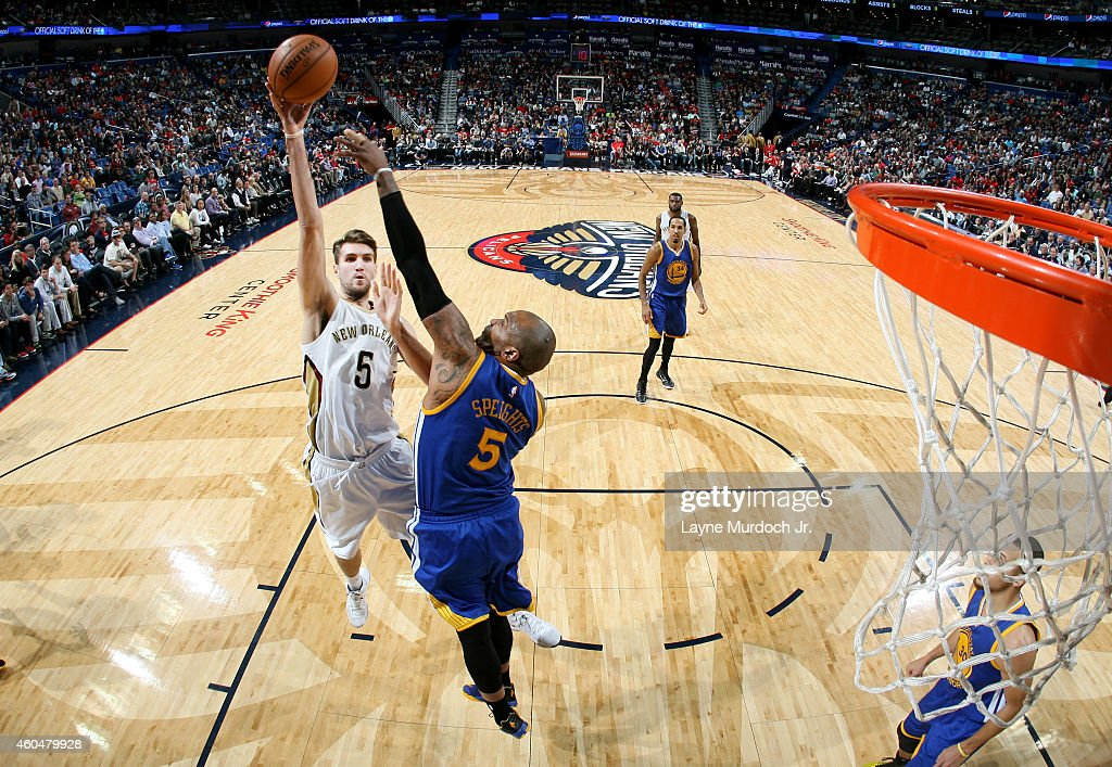Jeff Withey #5 of the New Orleans Pelicans shoots against Marreese Speights #5 of the Golden State Warriors during an NBA game on December 14, 2014 at the Smoothie King Center in New Orleans, Louisiana.