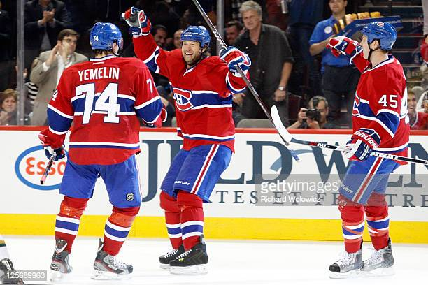Jeff Woywitka of the Montreal Canadiens celebrates his second period goal with team mates Alexei Yemelin and Michael Blunden during the NHL preseason...