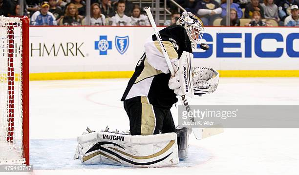 Jeff Zatkoff of the Pittsburgh Penguins makes a save against the Dallas Stars during the game at Consol Energy Center on March 18 2014 in Pittsburgh...