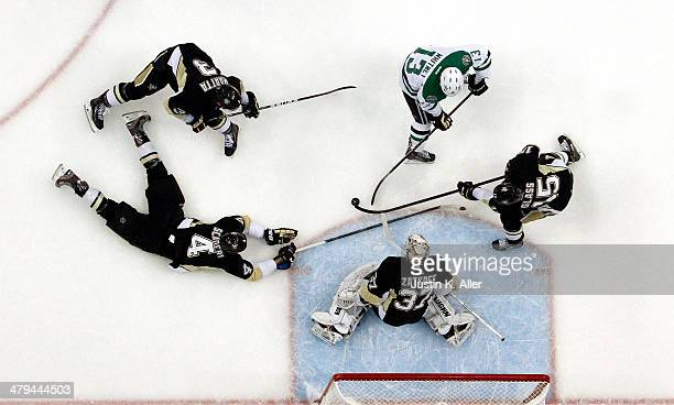 Jeff Zatkoff of the Pittsburgh Penguins makes a save on Ray Whitney of the Dallas Stars during the game at Consol Energy Center on March 18 2014 in...