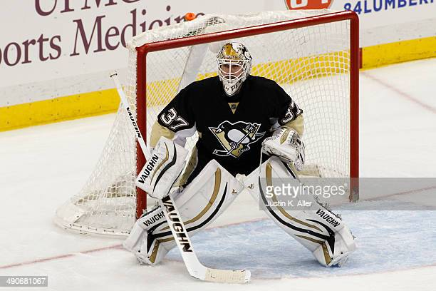 Jeff Zatkoff of the Pittsburgh Penguins protects the net against the Ottawa Senators during the game at Consol Energy Center on April 13 2014 in...